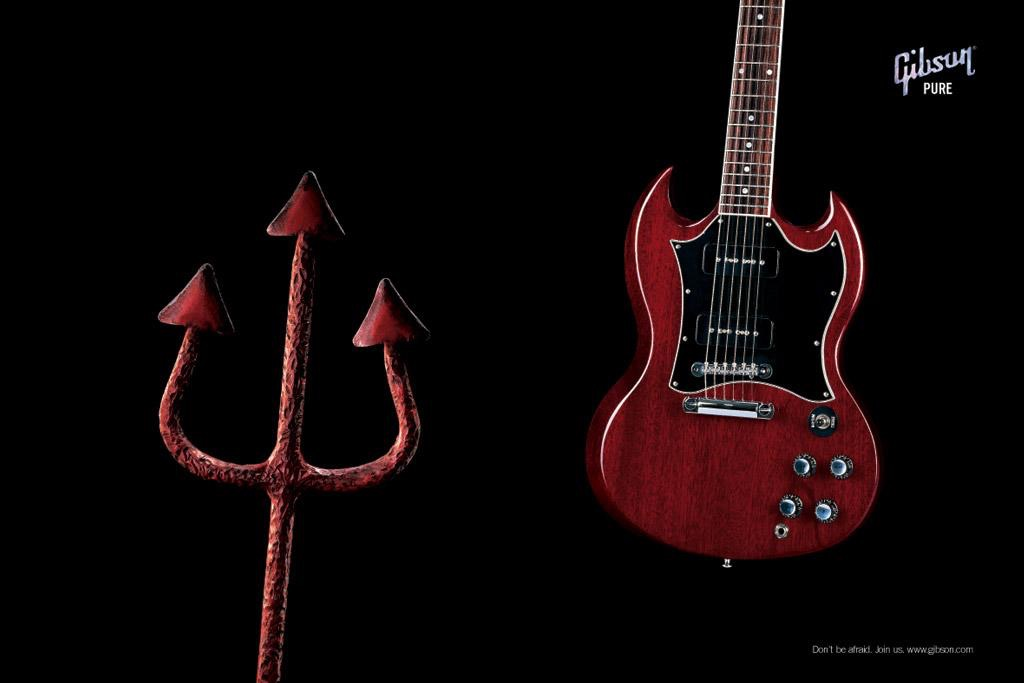 Gibson_Pure_Ad_Don't_Be_Araid_Heavy_Metal_Devil_Gibson_SG